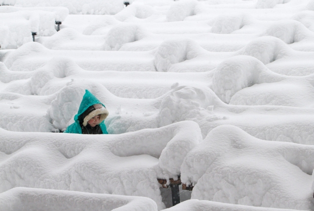 A child walks in a park after heavy snowfall in Kiev, Ukraine, on Dec. 11. (Anatolii StepanovReuters) #