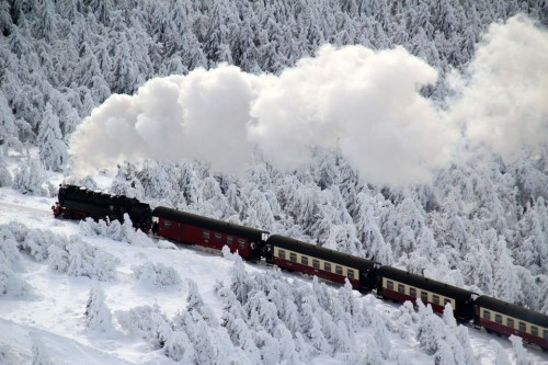 POSTCARD PERFECT A train rolled through a winter landscape with snow-covered trees on the Brocken, the tallest peak in northern Germany's Harz mountain range, Saturday. (Stefan RampfelDPAZuma Press)