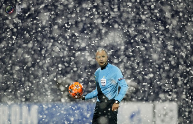 Referee Todorov of Bulgaria gestures as match was halted due to snow on pitch during Champions League Group A soccer match in Zagreb. ANTONIO BRONICREUTERS
