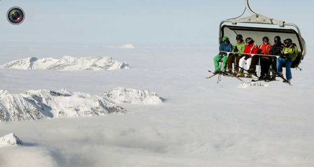 Skiers sit in a chairlift at the Mount Titlis skiing area near the Swiss mountain resort of Engelberg. ARND WIEGMANNREUTERS