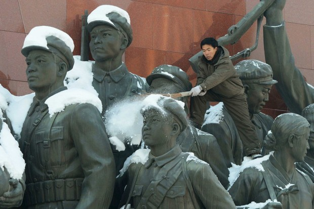 SWEEPING SNOW A man brushed snow from the top of a monument in Pyongyang, North Korea, Monday. (KyodoReuters)